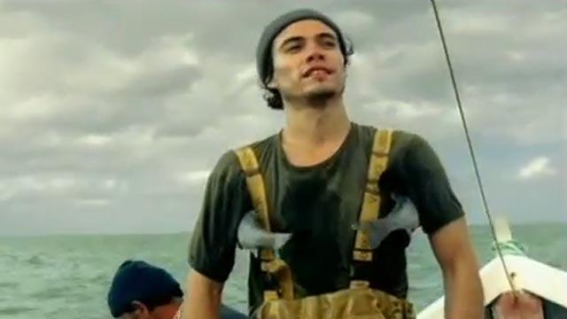 publicité Axe : pêcheur avec poissons sous les bras